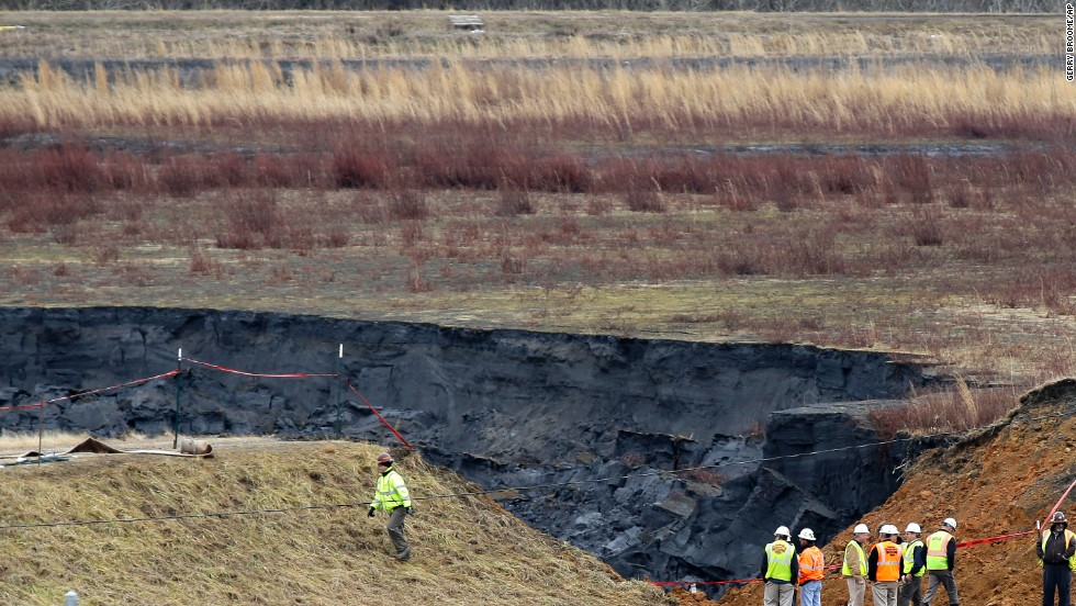 Duke Energy engineers and contractors survey the site of a coal ash spill at the Dan River power plant in Eden, North Carolina, on February 5.