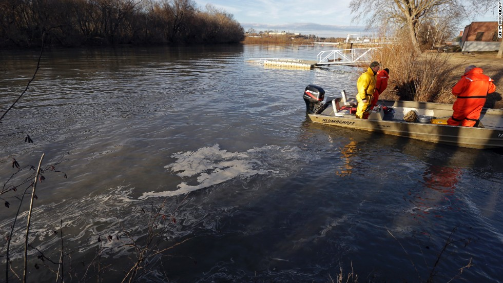 State and federal officials dock after collecting sediment samples as coal ash floats on the water of the Dan River on February 5.