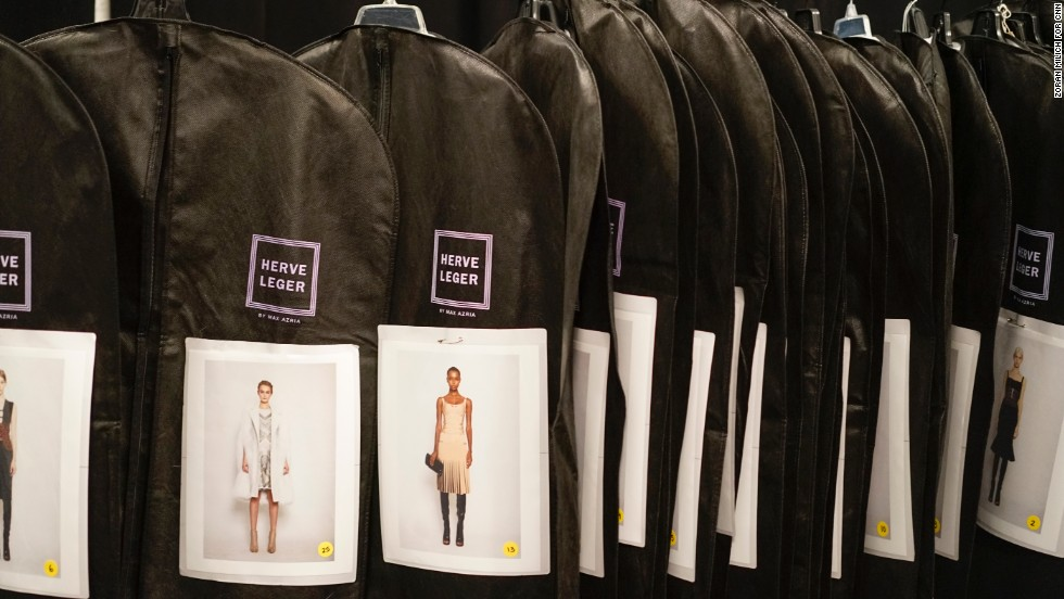 Garment bags for each Herve Leger model are organized in order of appearance on the runway.