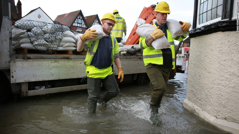 Electricity workers unload sandbags February 10 to protect a substation in Datchet.