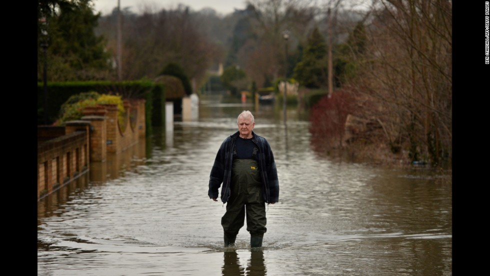 A resident in Wraysbury, England, walks through floodwaters on February 10. England just suffered its wettest January since 1766.