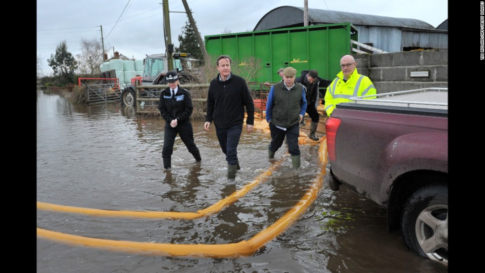 British Prime Minister David Cameron, second left, visits Goodings Farm in Fordgate on February 7.