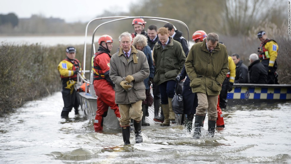 Prince Charles walks through floodwater near Muchelney, England, on Tuesday, February 4.