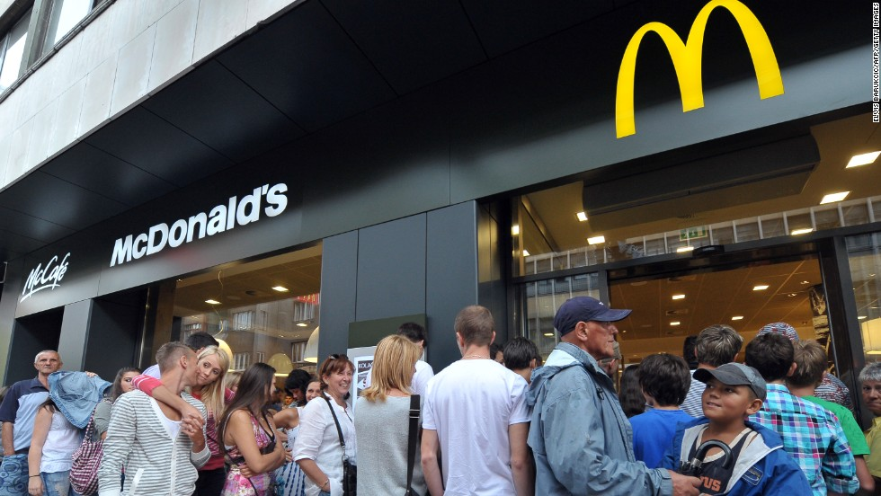 People wait in line at the first Bosnian McDonald's restaurant in the capital, Sarajevo, which opened in 2011 after a four year battle with local shop and cafe owners, and the country's government.