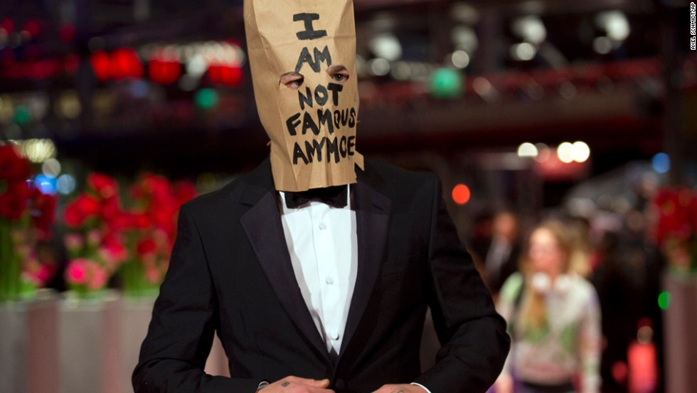 "Although LaBeouf didn't stay for ""Nymphomaniac's"" media event, he did show up for the premiere wearing one eye-catching accessory: a paper bag over his head bearing his favorite phrase, ""I AM NOT FAMOUS ANYMORE,"" scrawled in black marker."