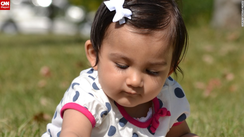 """Hey Mom ... I am picking some fresh greens for salad today"" -- Rhea Purohit, age 9 months, forages in New Jersey's Liberty State Park."