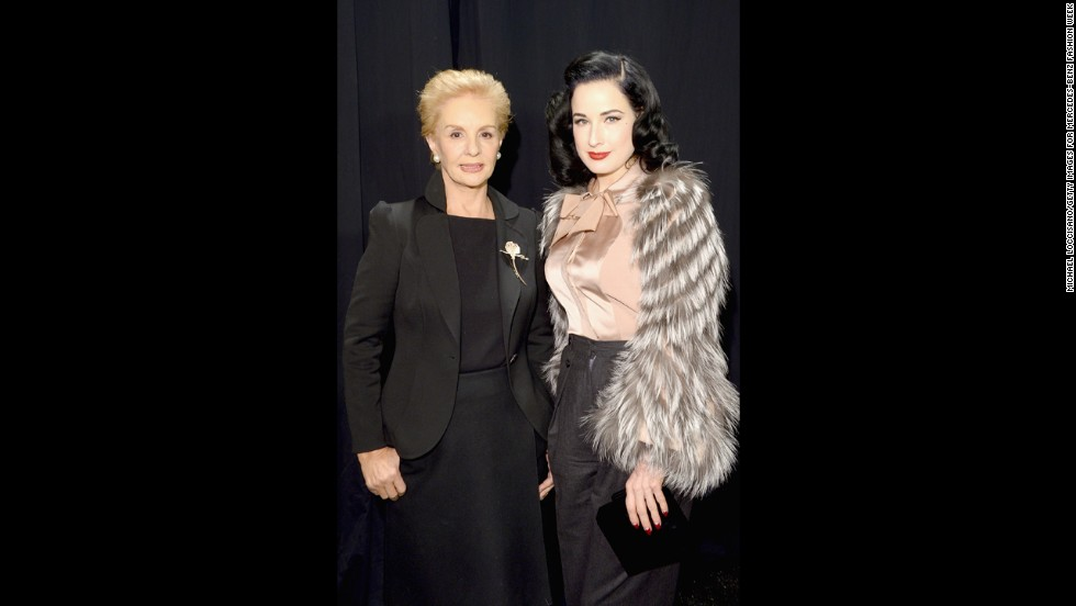 Designer Carolina Herrera, left, poses with fashion muse and burlesque dancer Dita Von Teese backstage at Mercedes-Benz Fashion Week in February.