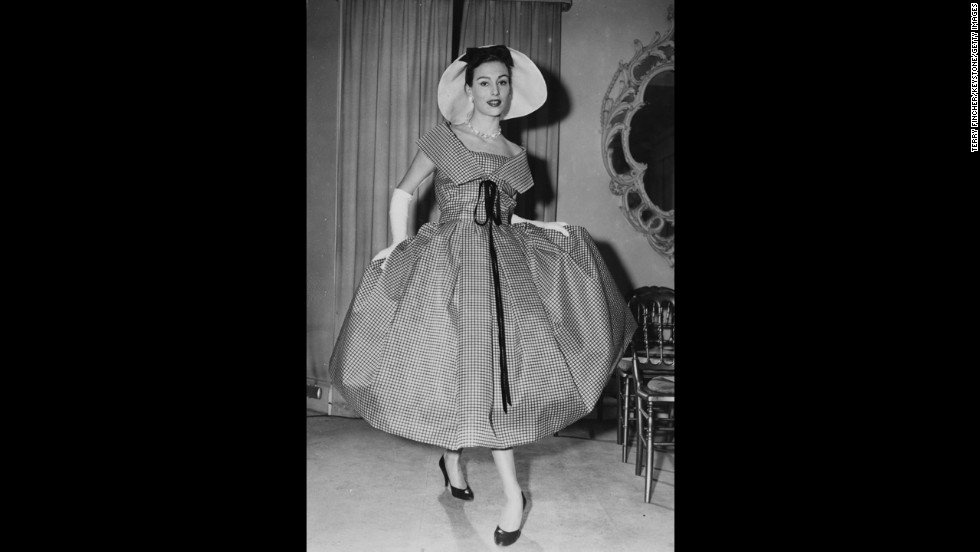 In 1957, Pagan Grigg models a black-and-white window pane-check organza dress from Christian Dior.
