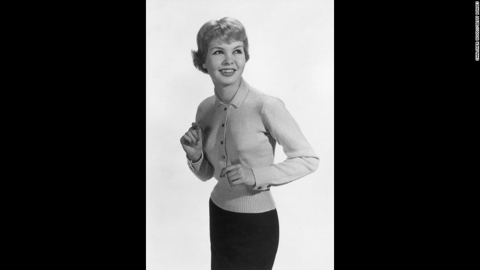 A fitted waist and collar are the noticeably ladylike elements of this cardigan, circa 1957.