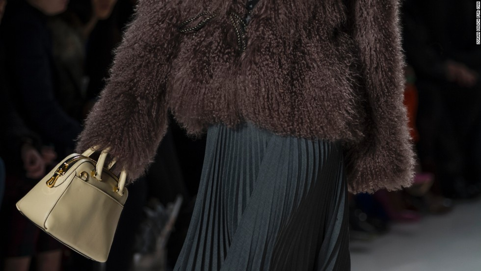 Michelle Smith paired a fur sweater with a flowing, pleated skirt for one of her looks.