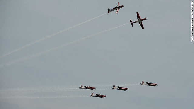 Indonesia's TNI-AU Jupiter Aerobatic Team perform at a media preview for the Singapore Airshow.