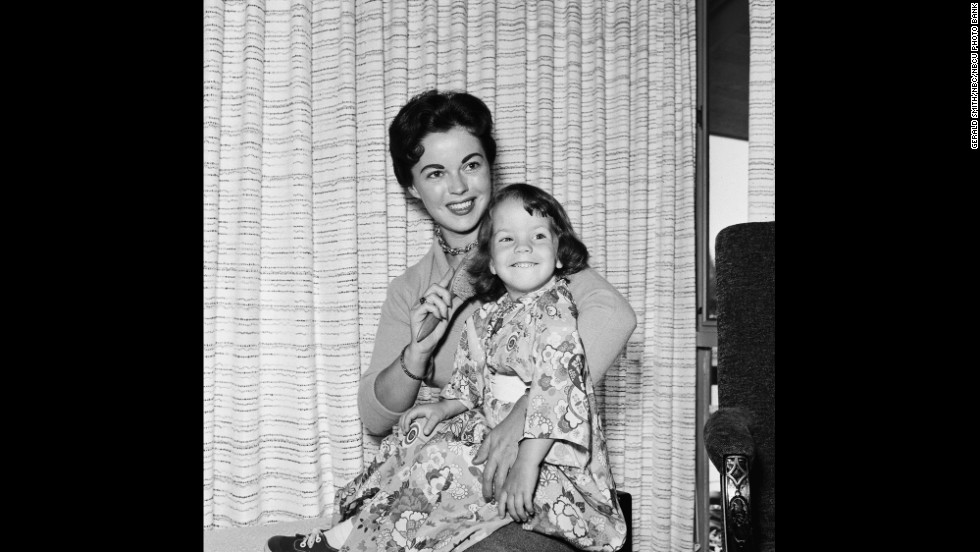 Temple Black sits with her daughter Lori Black at their home in 1957.