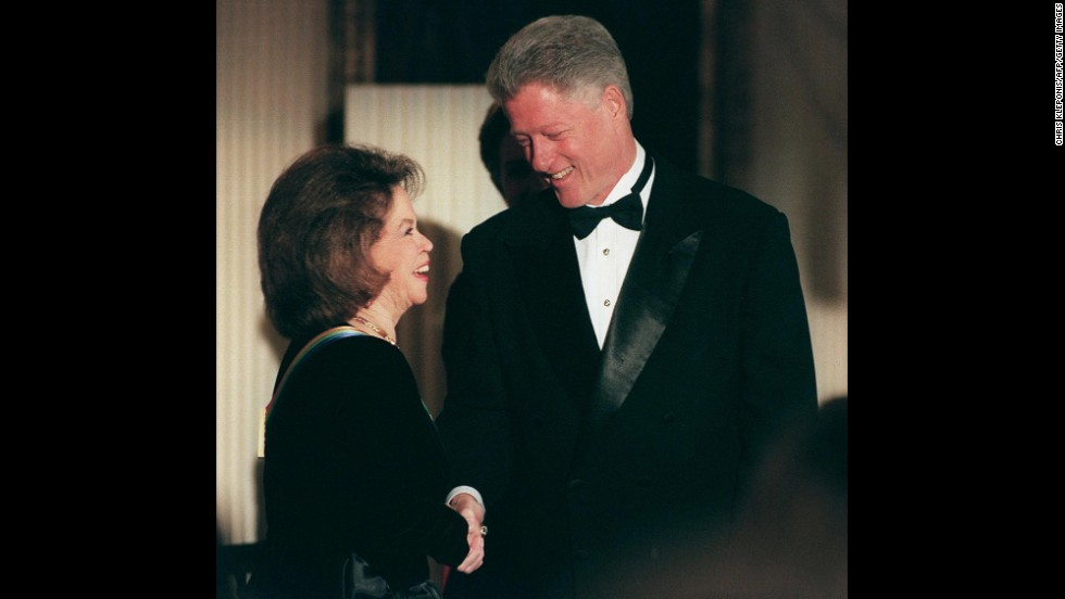 President Bill Clinton greets Temple Black during a reception prior to the 1998 Kennedy Center Honors.