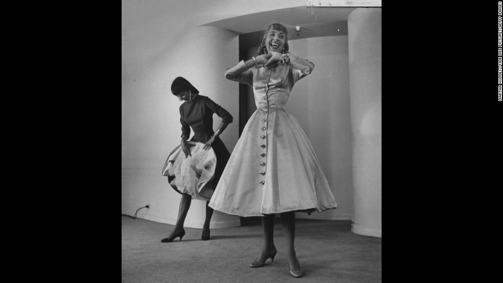 "The 1950s saw a return to a more feminine style, with designer Anne Fogarty (pictured) leading the way. ""Fogarty had the tiniest, tiniest waist, and made all these corseted dresses -- but also was a successful career woman herself,"" said Arnold. ""It was a combination of being very 'housewifey' but also very powerful and dramatic."""