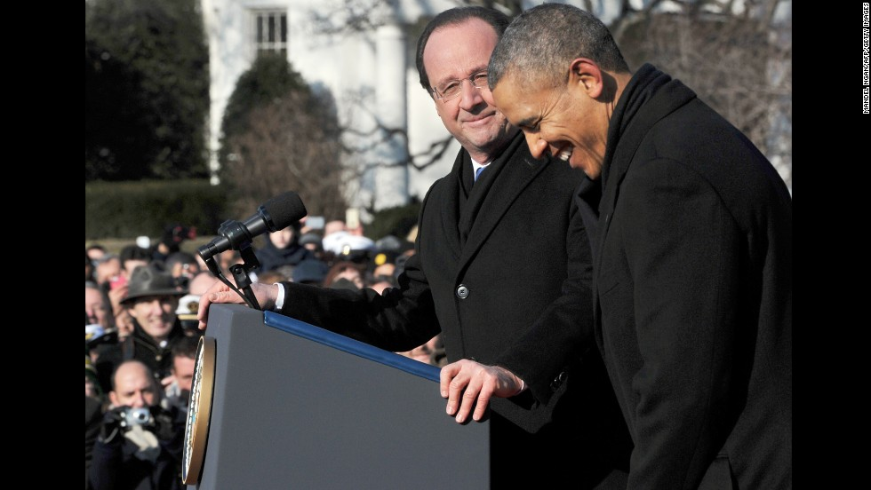 Hollande pauses as Obama laughs during the official welcome ceremony on the South Lawn.