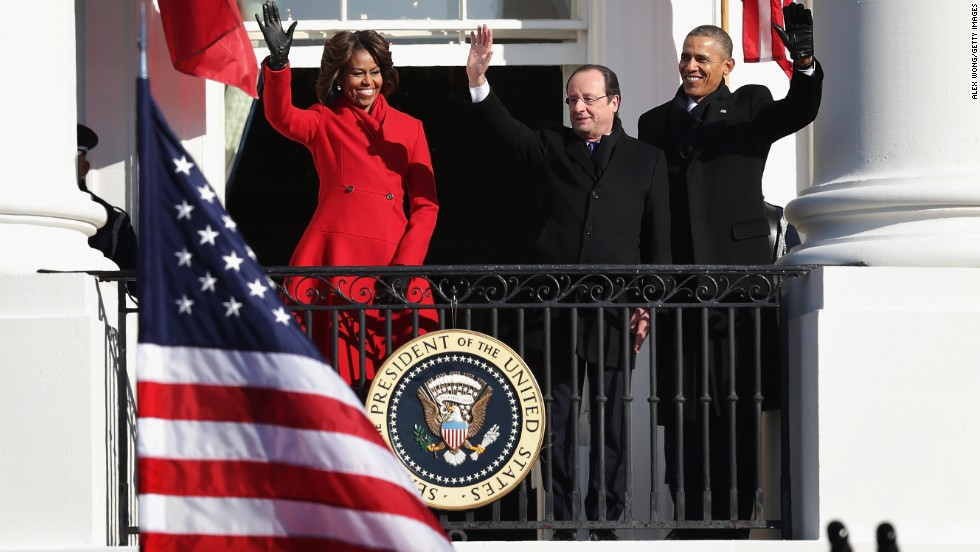 Obama, Hollande and first lady Michelle Obama wave from a White House balcony on February 11.