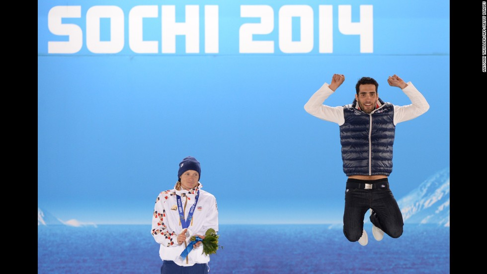A picture taken with a robotic camera shows French biathlete Martin Fourcade, right, celebrating his gold medal in the 12.5-kilometer pursuit. To his right is silver medalist Ondrej Moravec of the Czech Republic.