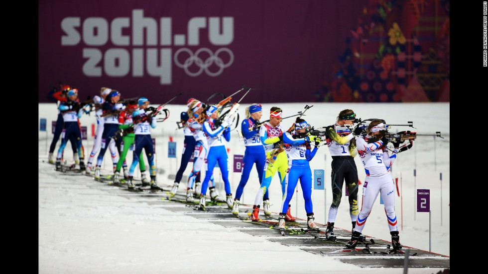 Biathletes compete in the women's 10-kilometer pursuit on February 11.