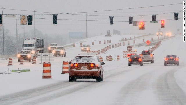 Early morning commuters navigate icy roads in Decatur, Ala., after snow fell overnight Tuesday, Feb. 11, 2014. (AP Photo/The Decatur Daily, John Godbey/The Decatur Daily/aP)