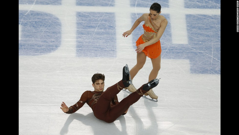 Italy's Matteo Guarise falls during his performance with Nicole Della Monica during pairs figure skating on February 11.