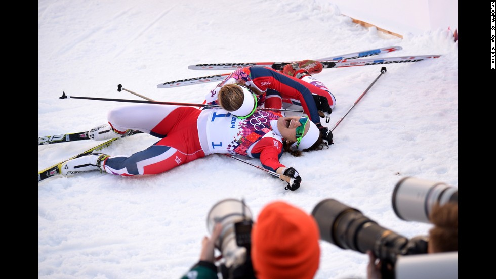 Norway's Ingvild Flugstad Oestberg, top, and Maiken Caspersen Falla celebrate after finishing second and first, respectively, in the women's cross-country sprint on February 11.