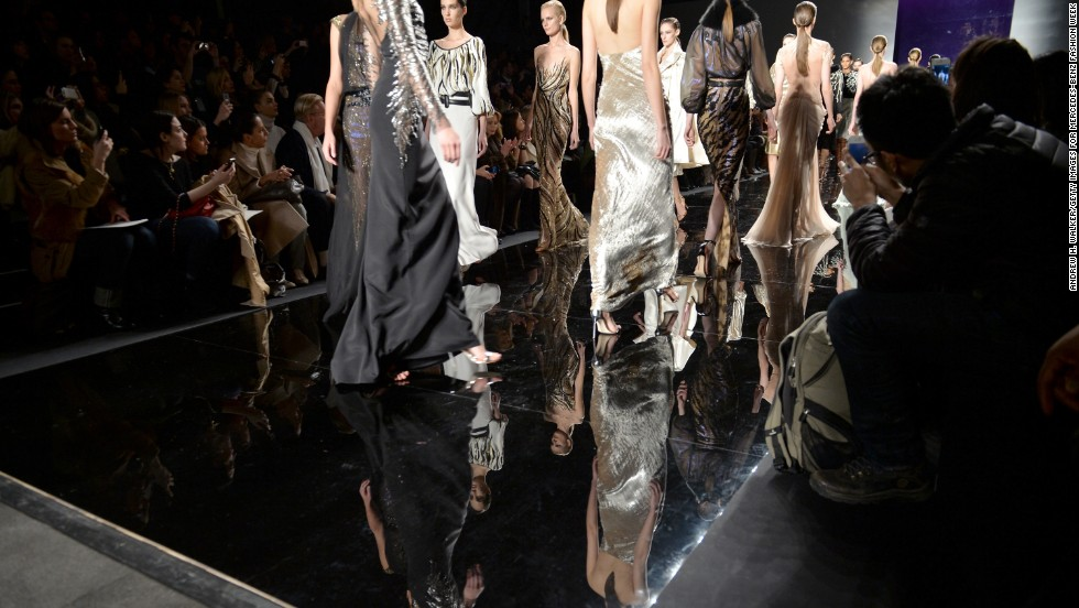 "FEBRUARY 10 - NEW YORK, U.S.: Models walk the runway during <a href=""http://edition.cnn.com/SPECIALS/living/nyfw/index.html"">Mercedes-Benz Fashion Week in NYC</a>. The show gives designers the first chance to showcase their fall 2014 collections. New York is traditionally the first of the four ""glamour capitals"" to host the season's fashion shows, with London, Paris and Milan to follow."