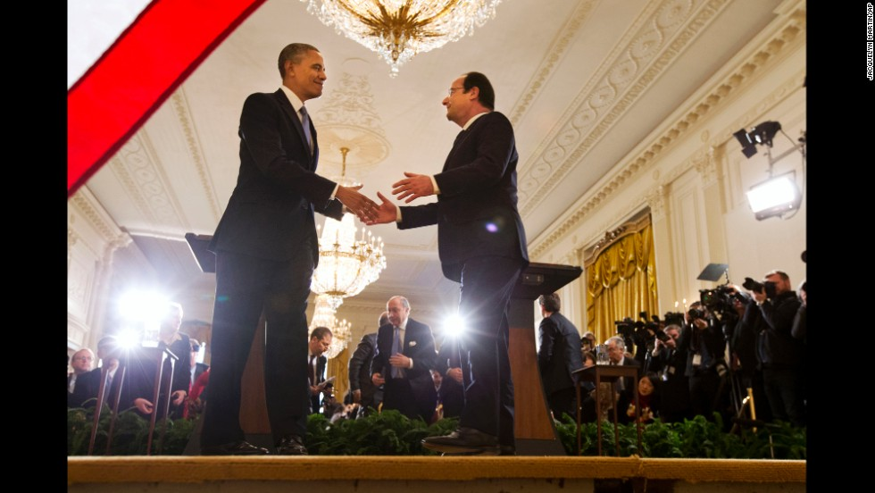 Obama shakes hands with Hollande after their news conference in the East Room of the White House in Washington.