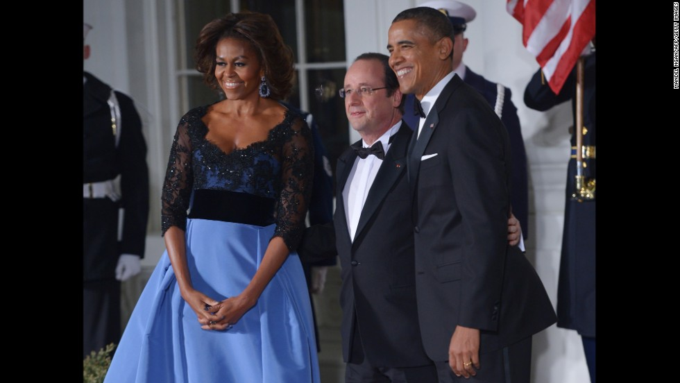 The President and the first lady pose with Hollande as he arrives for the state dinner at the North Portico of the White House.