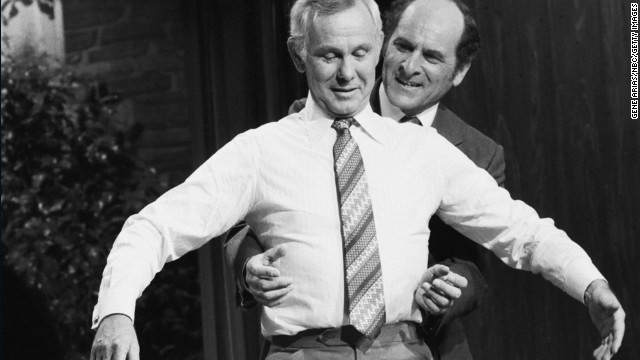 "Dr. Henry Heimlich demonstrates the Heimlich maneuver on host Johnny Carson while appearing on ""The Tonight Show"" on April 4, 1979."