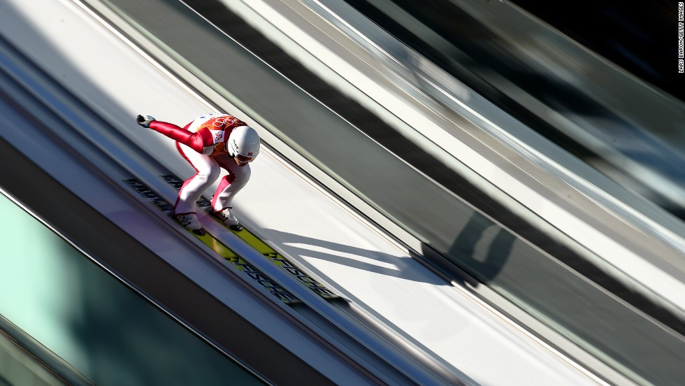 Magnus Krog of Norway slides down the normal hill ski jumping ramp during the Nordic combined on February 12.