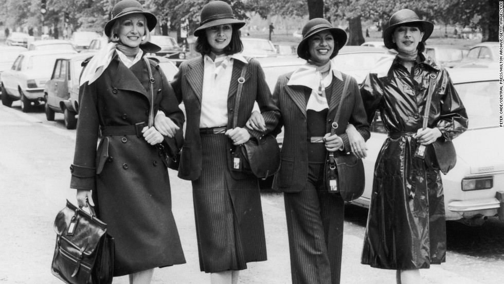 British Airways staff show off their new uniforms in 1977. Over the years, many airlines have commissioned outfits from top designers, such as Yves Saint Laurent for Qantas in the 1980s, Giorgio Armani for Alitalia in the 1990s, and Christian Lacroix for Air France in the 2000s.
