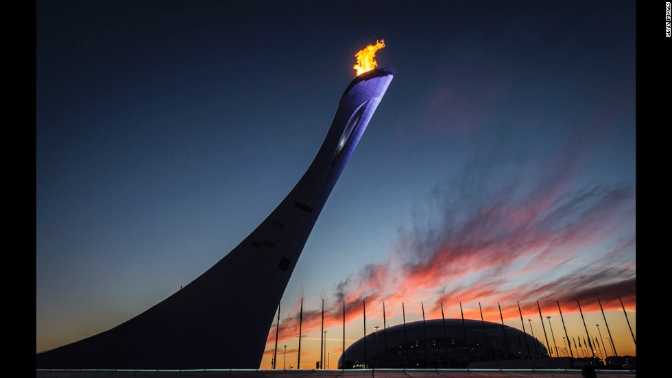 The Olympic cauldron blazes in front of the Bolshoy Ice Dome at sunset February 12.