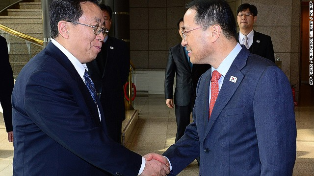 "Head of the North Korean high-level delegation Won Tong Yon (L) shakes hands with his South Korean counterpart Kim Kyou-hyun (R) prior to their talks at the truce village of Panmunjom in the Demilitarised Zone (DMZ) on February 12, 2014. North and South Korean officials held their highest level talks for years, seeking to thrash out common ground for improving ties despite a row over looming South Korea-US military drills. REPUBLIC OF KOREA OUT AFP PHOTO / UNIFICATION MINISTRY / YONHAP ----EDITORS NOTE---- RESTRICTED TO EDITORIAL USE - MANDATORY CREDIT ""AFP PHOTO / UNIFICATION MINISTRY / YONHAP"" NO MARKETING NO ADVERTISING CAMPAIGNS - DISTRIBUTED AS A SERVICE TO CLIENTSUNIFICATION MINISTRY/AFP/Getty Images"