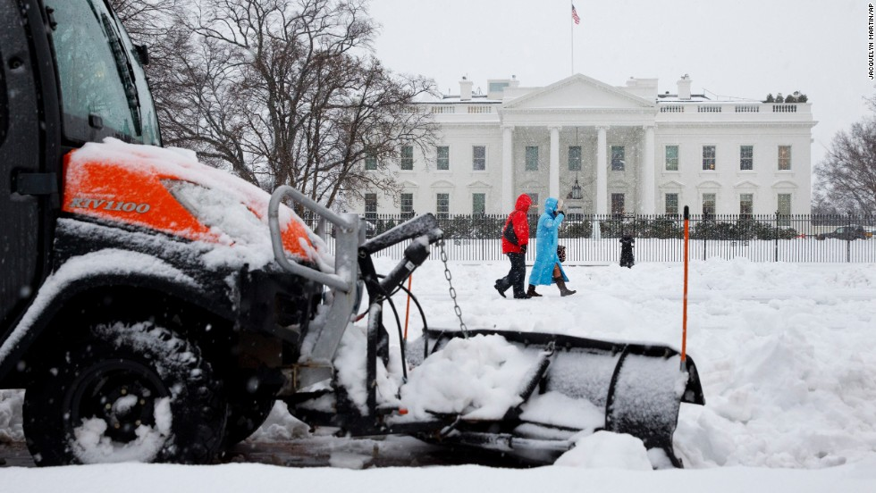 A snowplow removes snow from the sidewalk in Washington's Lafayette Park, across the street from the White House, on February 13.