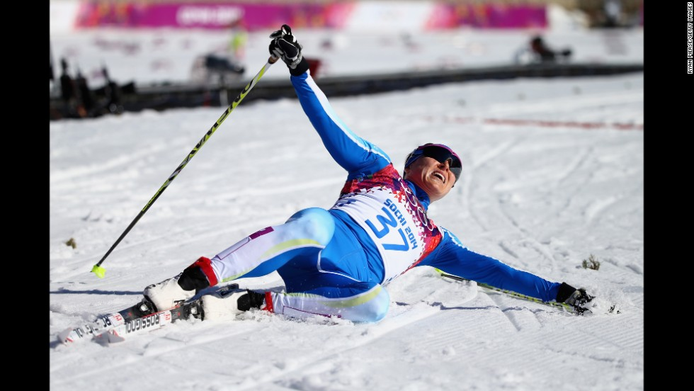 Aino-Kaisa Saarinen of Finland reacts after crossing the finish line during the women's 10-kilometer classic.
