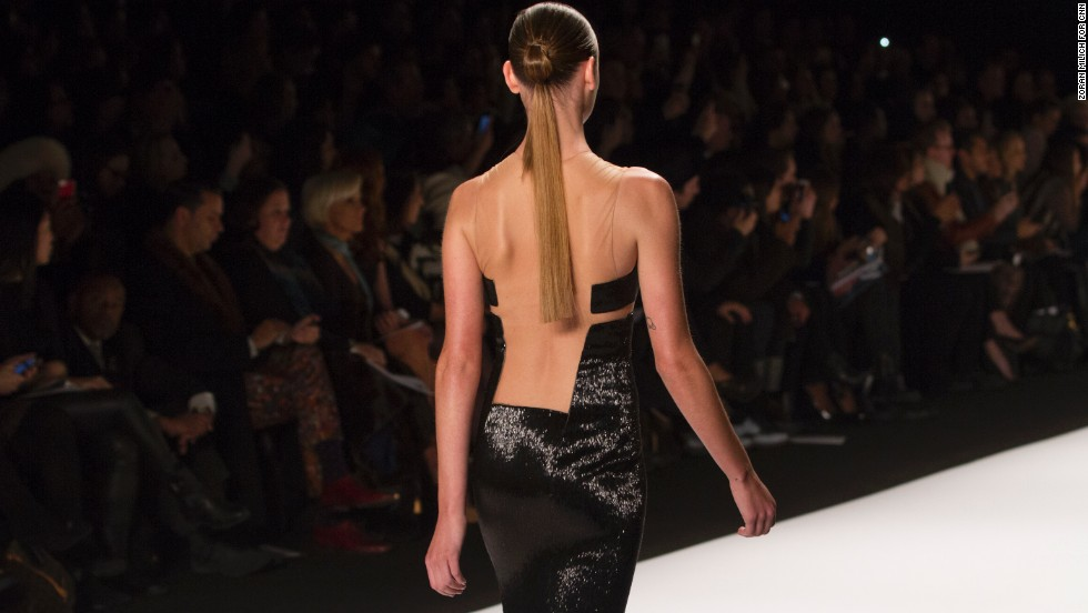 A model walked graced the runway in a little black dress with an edgy open back.