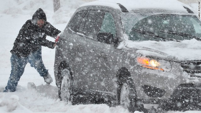 A Good Samaritan in Bethlehem, Pa., helps push a stranded motorist stuck in deep snow on Stefko Boulevard Thursday, Feb. 13, 2014. A weather system arrived in Pennsylvania with the potential to be the biggest storm of an already memorable winter season.     (AP Photo/Chris Post)