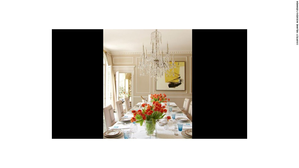 This dining room, designed by Miles Redd, from the March/April 2013 issue of Veranda, puts the focus on a magnificent chandelier to cast a soft, romantic glow over dinner.