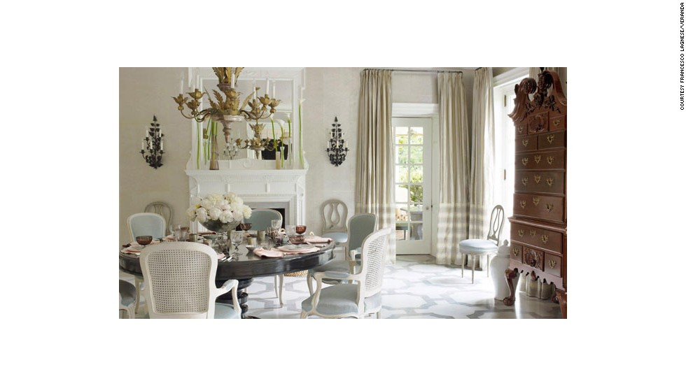 This dining room, designed by Bunny Williams, from the January/February 2013 issue of Veranda, emphasizes the communal aspect of dining with a round table. It offers plenty of candlelight potential for romantic meals.