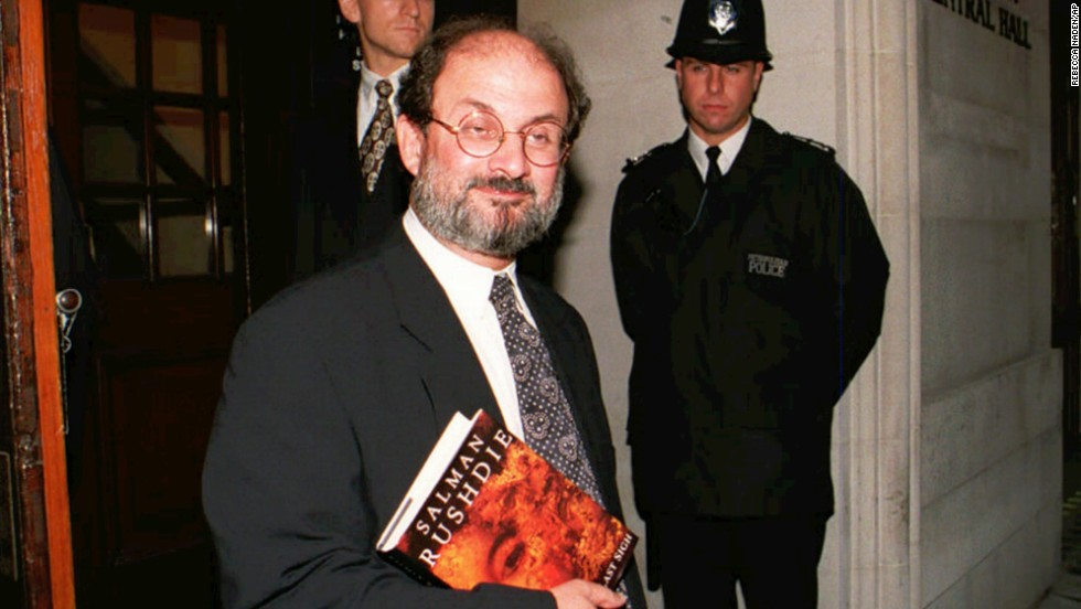 "Rushdie arrives at London's Central Hall on Thursday September 7, 1995, to participate in a public forum ""Writers Against the State.""  Rushdie holds under his arm a copy of ""the Moor's Last Sigh,"" his first major novel since ""The Satanic Verses."""