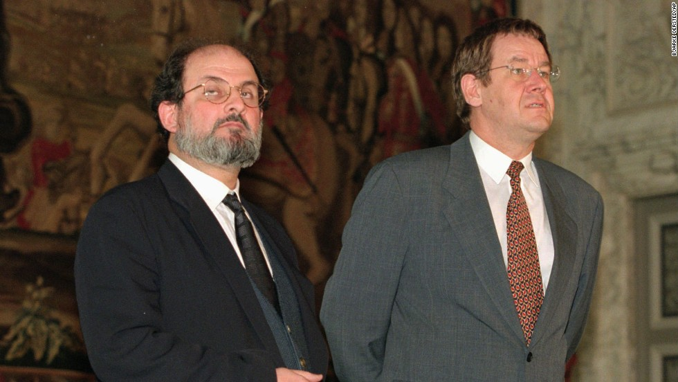 Rushdie and Danish Prime Minister Poul Nyrup Rasmussen talk to the press at Christiansborg Castle in Copenhagen on November 13, 1996. Rushdie traveled to Copenhagen to receive a literary award after the Danish government canceled earlier plans because of a threat to Rushdie's life.