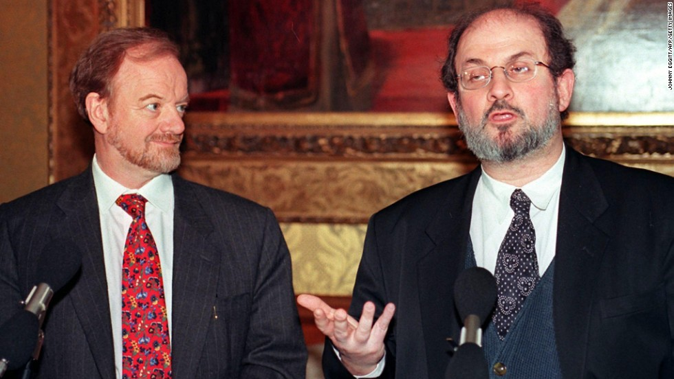 British Foreign Secretary Robin Cook listens to Salman Rushdie during a press conference in February 1998, the ninth anniversary of the fatwa by Iran.