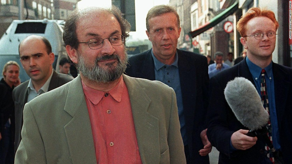 Rushdie takes an early morning stroll in the company of several security guards in London on September 25, 1998 -- his first day in nine years without a state-sponsored threat on his life.  Iran distanced itself from a religious edict against Rushdie in order to resume diplomatic relations with the UK.