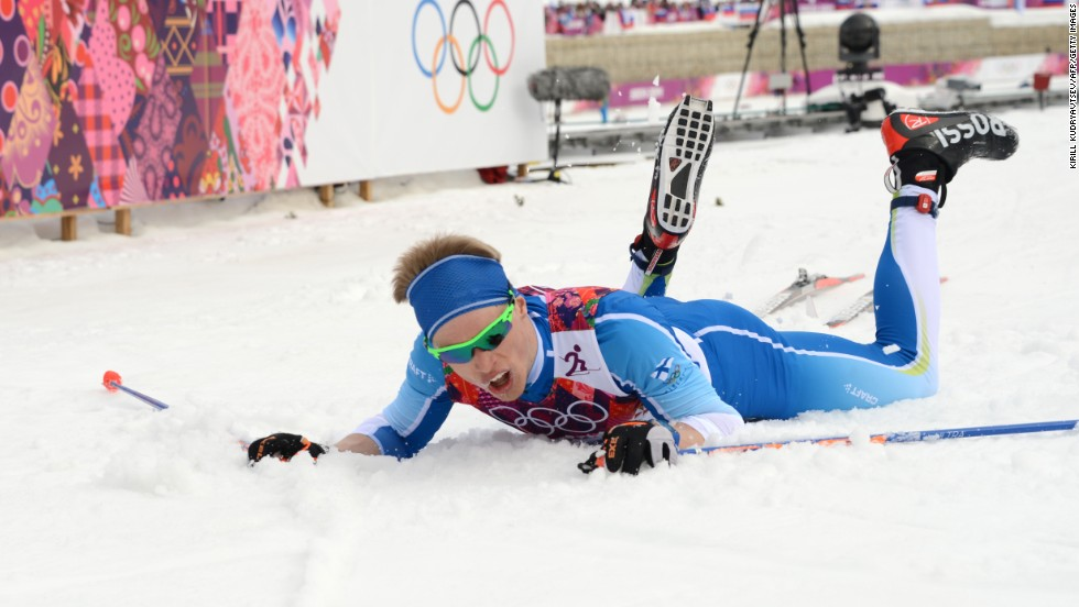 Cross-country skier Iivo Niskanen of Finland lies on the snow at the finish line of the men's 15-kilometer classic.