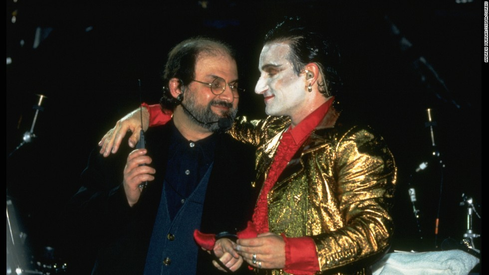 Rushdie appears on stage with Bono from the band U2 on August 11, 1993, at Wembley Stadium in London. With the author in hiding, the band invited him to appear as an act of solidarity.