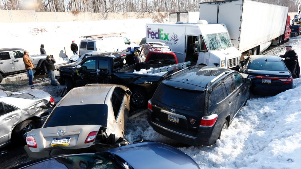 Vehicles are piled up in an wreck Friday, February 14, in Bensalem, Pennsylvania. Traffic accidents involving multiple tractor-trailers and dozens of cars completely blocked one side of the Pennsylvania Turnpike outside Philadelphia.