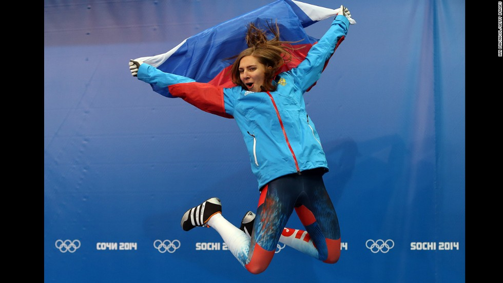 Elena Nikitina of Russia celebrates her bronze medal after the skeleton final on February 14.