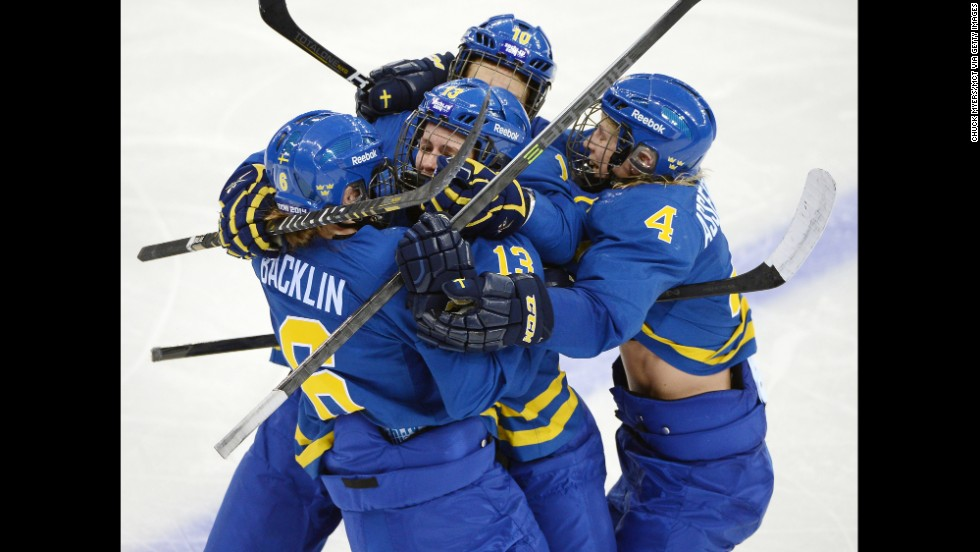 The women's hockey team from Sweden celebrates a goal against Finland on February 15.
