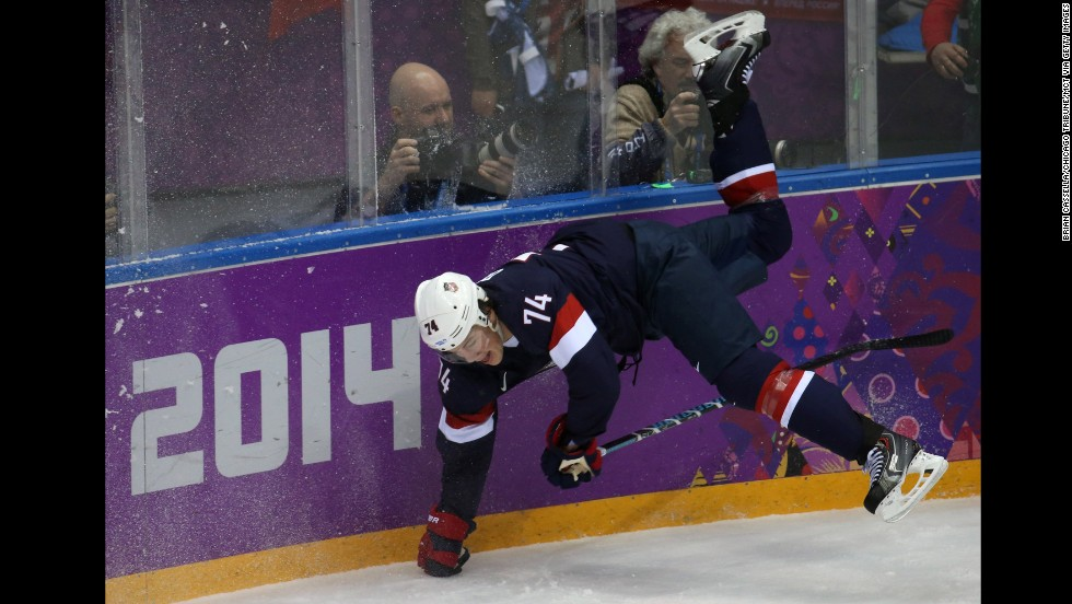 U.S. forward T.J. Oshie goes flying into the boards during the first period of the men's hockey game against Russia on February 15.