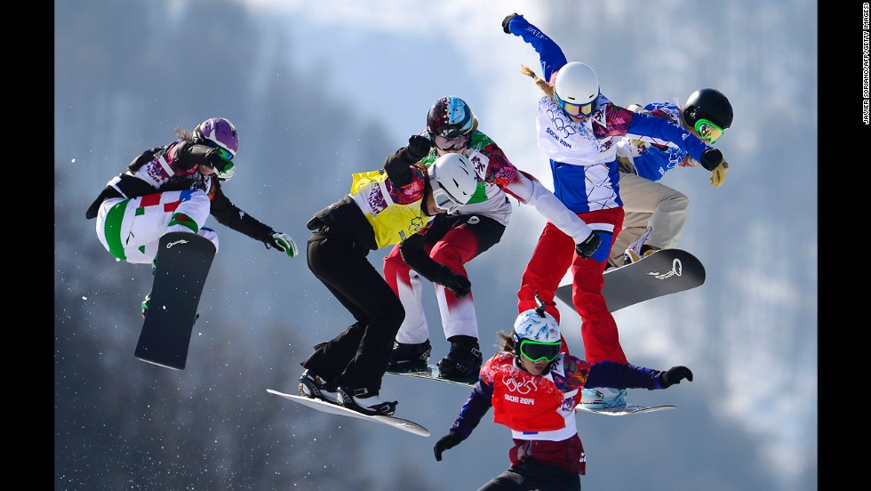 Athletes race in the final of the women's snowboard cross on February 16.